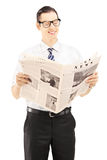 Young businessperson reading a newspaper Stock Images