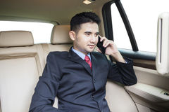 Young businessperson speaking on the phone Stock Photography