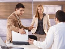 Young businessteam talking in office smiling Royalty Free Stock Photo