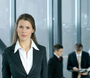 A young businesswiman in front of her colleagues Royalty Free Stock Photos