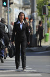 Young businesswoman. Crossing the street in a city Royalty Free Stock Photos