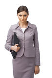 Young Businesswoman. Portrait of a young confident businesswoman holding a clipboard Royalty Free Stock Image