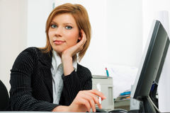 Young business woman using computer Stock Images