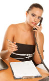 Young businesswoman. Holding a telephone working in office Stock Photo