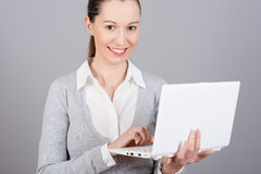 Young businesswoman. Portrait of a pretty young businesswoman holding a laptop Royalty Free Stock Image