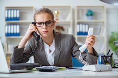 The young businesswoman accountant working in the office. Young businesswoman accountant working in the office Royalty Free Stock Image