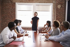 Young Businesswoman Addressing Boardroom Meeting Stock Images