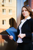 Young businesswoman against an office door Stock Photo