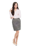Young businesswoman against white background Stock Photo