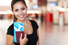 Young businesswoman airport. Close up portrait of young businesswoman at airport holding flight ticket Royalty Free Stock Photos