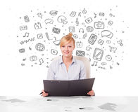 Young businesswoman with all kind of hand-drawn media icons in b Stock Images