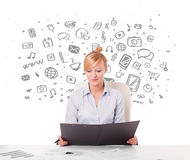 Young businesswoman with all kind of hand-drawn media icons in b Stock Photos
