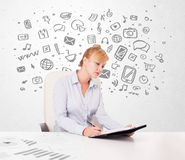 Young businesswoman with all kind of hand-drawn media icons in b Stock Photo