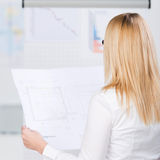 Young Businesswoman Analyzing Blueprint Stock Image