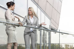 Young businesswoman arguing with female colleague at office balcony Royalty Free Stock Images
