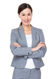 Young businesswoman with armed crossed. Isolated on white background Royalty Free Stock Photography
