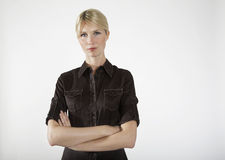 Young Businesswoman With Arms Crossed Stock Photo