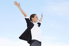 Young businesswoman with arms out royalty free stock photo