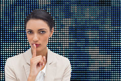 Young businesswoman asking for silence Royalty Free Stock Image