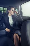 Young businesswoman in back of car Royalty Free Stock Image