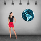 Young businesswoman on the background of earth model Royalty Free Stock Photography