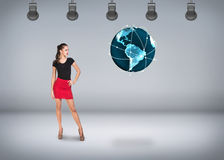 Young businesswoman on the background of earth model Stock Image