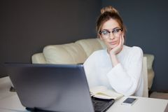 Young businesswoman. Beautiful girl with glasses working at home with laptop Royalty Free Stock Photos