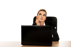Young businesswoman behind the desk, using laptop Stock Photo