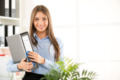 Young Businesswoman With Binder Royalty Free Stock Photos