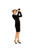 Young businesswoman with a binocular Royalty Free Stock Images