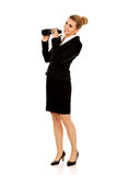 Young businesswoman with a binocular Stock Image