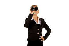 Young businesswoman with a binocular Royalty Free Stock Image