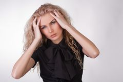 Young businesswoman in black blouse having a heada Stock Image