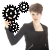 Young businesswoman with black gears isolated Stock Photos