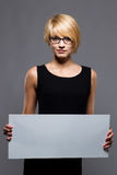 Young businesswoman with blank board. Copyspace. Beautiful young businesswoman with blank board. Copyspace Stock Images