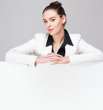 Young businesswoman with blank sign. Royalty Free Stock Photo