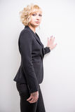 Young businesswoman. Young blonde woman wearing black business suit Royalty Free Stock Image