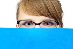 Young businesswoman with blue folder Royalty Free Stock Photo