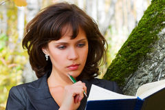 Young businesswoman with a book. Stock Images
