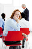 Young businesswoman bored at a conference Stock Photography