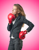 The young businesswoman in boxing concept Stock Photos
