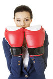 Young businesswoman with boxing gloves Stock Photo