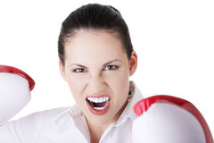 Young businesswoman with boxing gloves Royalty Free Stock Photos