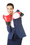 Young businesswoman with boxing gloves Royalty Free Stock Photo