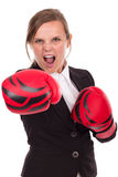Young businesswoman with boxing gloves punching ready to fight, Stock Photography