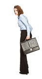 Young businesswoman with briefcase runing away in fright Stock Photography