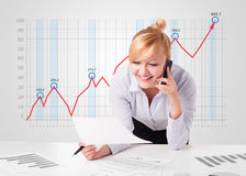 Young businesswoman calculating stock market with rising graph i Stock Photo