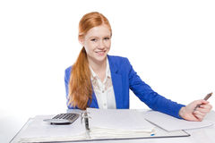 Young businesswoman is  calculating and writing on a paper Royalty Free Stock Image