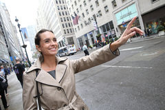 Young businesswoman calling a cab Stock Photography