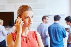 Young businesswoman calling on the phone Stock Photo
